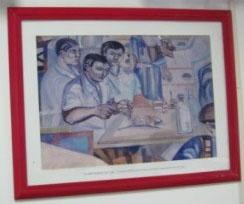 国民的画家ジェンネル・アウグストによって1955年に描かれた、バイーア連邦大学医学部で研究中の野口英世を描いた絵の複製画(写真=毛利さん提供)