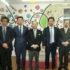 (左から)大山泰弘事業部長、長谷川取締役、石塚尚最高顧問、田所社長、河野賢治主任