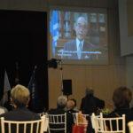 谷本知事のビデオメッセージが映し出された
