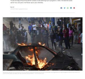 国家警備隊のビデオに応答し、軍兵士らの接近を阻止するために車に火を放つなどの抗議行動を行ったベネズエラの人々(21日付G1サイトの記事の一部)