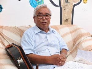 構想20年の希望城の計画を語る佐藤さん