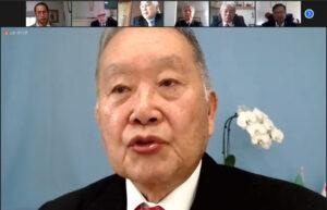 再選の挨拶をする石川会長